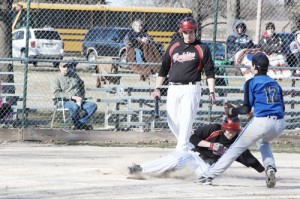 Sullivan's Andy Brown steals home on a passed ball Tuesday evening. The Redskins came back to upset OV in the bottom of the seventh inning to win 12-11.